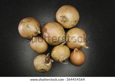 Eight raw yellow onions