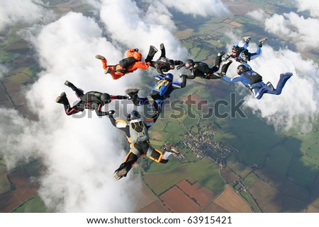 Eight skydivers in freefall - stock photo