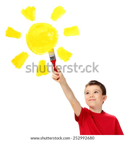 Eight years boy painting sun on white background - stock photo