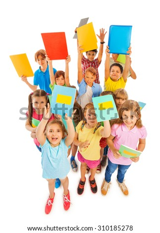 Eight years old kids lifting textbooks