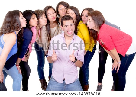 eight young women kissing  handsome man standing between them - isolated on white - stock photo