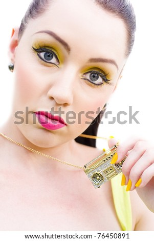 Eighties Rock And Roll Woman Gestures Her Passion For The Sound Of Music When Holding A Box Box Necklace Or Bling Bling In A 1980 Studio Image Isolated On White