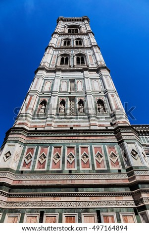 Eighty-five meter high tower Giotto's Campanile (designed in 1334 by Giotto di Bondone) - bell tower of the Basilica di Santa Maria del Fiore. Florence, Italy.