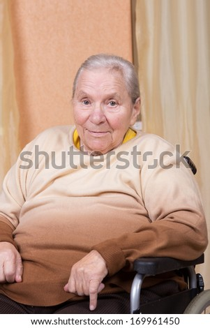 Eighty years old woman sitting in a wheelchair