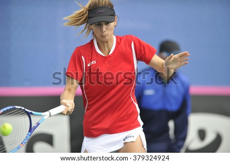 EILAT, ISRAEL - FEBRUARY 05, 2016: Professional tennis player Tsvetana Pironkova from Bulgarian national team in action during the BNP Paribas FedCup game 2016 at Eilat Tennis Center in Israel