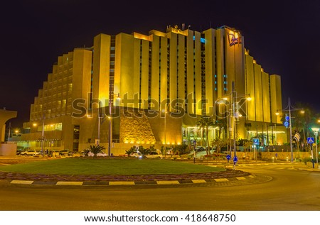 EILAT, ISRAEL - FEBRUARY 24, 2016: The night walk in the tourist district with brightly illuminated luxury hotels, cozy gardens and quiet streets, on February 24 in Eilat.