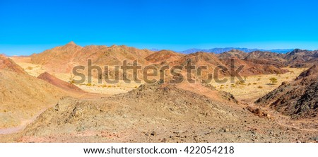 Eilat offers different types of recreation, hiking is one of the popular types in scenic Eilat Mountains, Israel. - stock photo