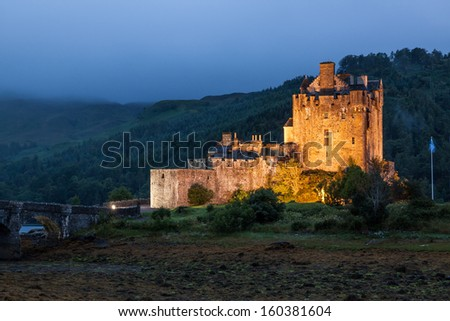 Eilean Donan Castle at dusk, Scotland, Uk - stock photo