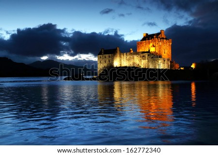 Eilean Donan Castle at dusk, Scotland, United Kingdom - stock photo