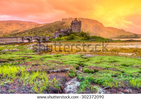 Eilean Donan Castle at sunset, Dornie, Kyle of Lochalsh in Scotland, United Kingdom. It is the most visited castle, situated on an island at the confluence of three sea lochs. - stock photo