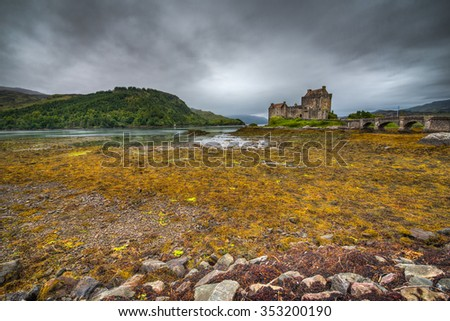 Eilean Donan Castle in Scotland on an overcast day.  - stock photo