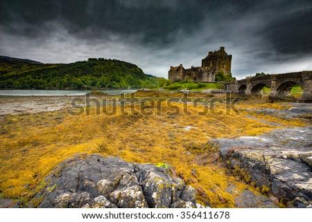 Eilean Donan Castle in Scotland, United Kingdom on a dark, overcast day. - stock photo