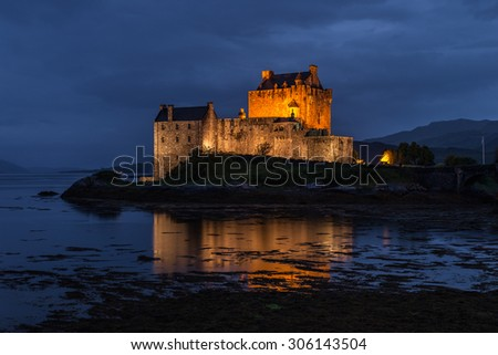 Eilean Donan castle in the night, Scotland - stock photo