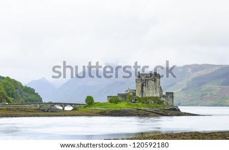 Eilean Donan Castle landmark in Loch Duich lake. Highlands of Scotland, Uk, Europe. Higlander movie location. - stock photo