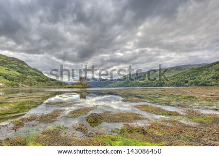Eilean Donan castle on a cloudy day, Highlands, Scotland, UK - stock photo