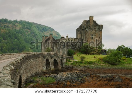 Eilean Donan castle on a cloudy day. low tide. Highlands, Scotland. UK - stock photo