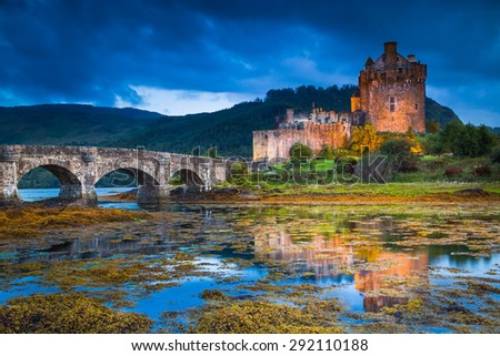 Eilean Donan Castle, Scotland, reflecting itself into the water during evening. - stock photo