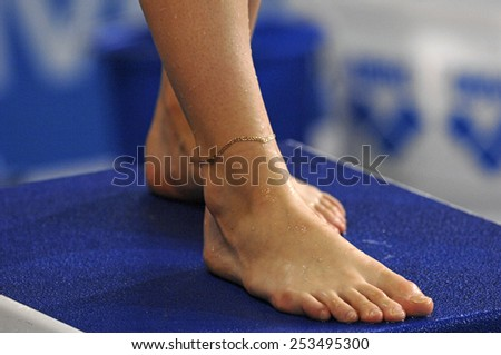 EINDHOVEN, HOLLAND-MARCH 20, 2008: close up of female diver feet standing on diving board during the European Swimming Championship, in Eindhoven. - stock photo