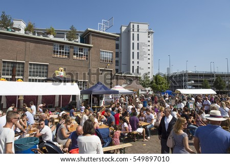 "EINDHOVEN, NETHERLANDS - AUGUST 23, 2015: Lot of visitors at the trendy ""Feelgood market"" for alternative food and lifestyle at former Philips ground"