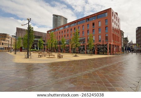 EINDHOVEN, NETHERLANDS - JUNE 23, 2013: Shopping and apartment building Catharinahuis on Catharinaplein. It was erected in 2003-2005 on the site of the oldest city house De Halve Maen - stock photo