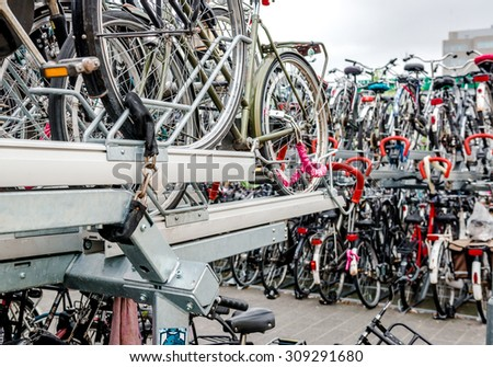 Eindhoven, Netherlands - May 23, 2015: Bicycle parking in Eindhoven Central Station. Bicycles are popular way to get around for the Dutch - stock photo