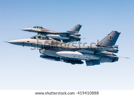 EINDHOVEN, THE NETHERLANDS - APRIL 20: Flight of two F-16 Falcons of the Belgian Air Force during an air refueling exercise. Eindhoven april 20, 2016, The Netherlands. - stock photo