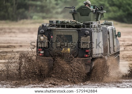 EINDHOVEN, THE NETHERLANDS, AUGUST 25 2016: An armored vehicle of the dutch army is riding through rough terrain.