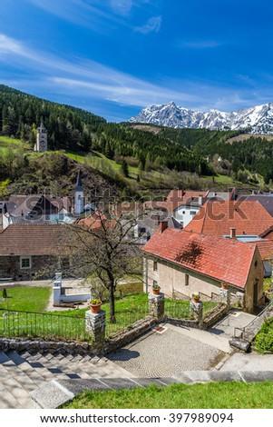 Eisenerz City Center And Alps Mountain Range In The Background - Eisenerz, Styria, Austria, Europe  - stock photo