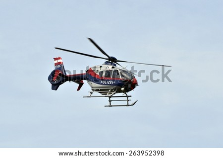 EISENSTADT, AUSTRIA - MAY 14: Austrian police helicopter - Eurocopter EC 135 - in operation for an accident, on May 14, 2011 in Eisnstadt, Austria