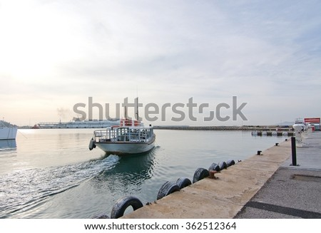 EIVISSA, IBIZA, BALEARIC ISLANDS, SPAIN - DECEMBER 17, 2015: Ferry boat leaving harbor and large ferry background on a sunny winter morning on December 17, 2015 in Ibiza, Balearic islands, Spain