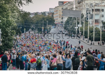 Ekaterinburg, Russia - August 01, 2015: General plan large group of athletes running during Marathon From Europe To Asia