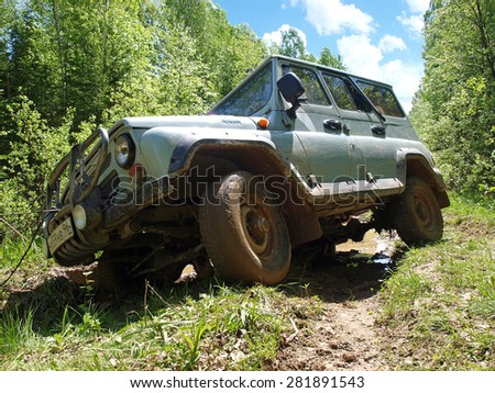 EKATERINBURG, RUSSIA - JUNE 06, 2009: Russian Plain Road in the heart of Siberia. 4 Wheel drive vehicle leaves the swamp