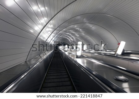 "EKATERINBURG, RUSSIA - MAY 19, 2014: Escalator metro station ""Chkalov"". The station opened on July 28, 1992"