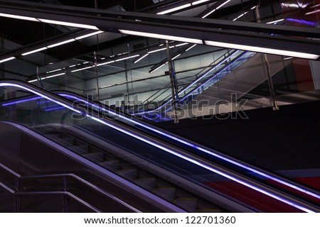 Eksalator blue light, stairway - Metro a station Barcelona - stock photo