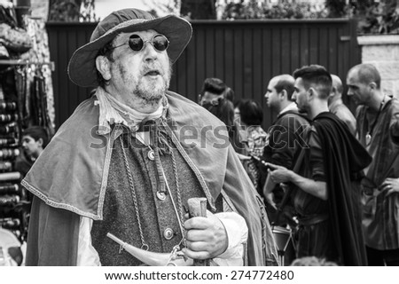 El Alamo, Madrid, Spain . May 1, 2015: An actor disguised as medieval personage tells histories to the public on a medieval market in Spain.