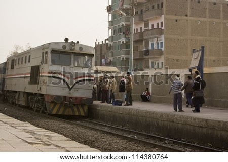 EL BALYANA, SOHAG, EGYPT - JANUARY 8: Passengers waiting for the train to Cairo on January 8 2012.  The railway service provides vital transport but is increasingly unreliable due to funding problems. - stock photo