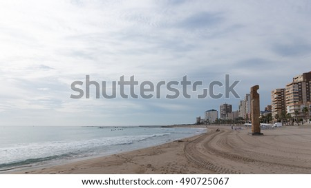 El Campello - October 3, 2015: Beautiful clean city beach with sand in the morning, in the fall 3 October 2015 El Campello, Costa Blanca, Spain