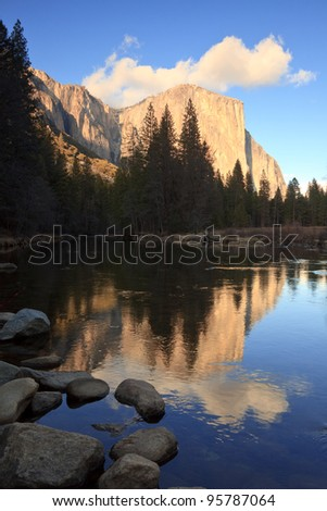 El Capitan at sunset, reflected in the Merced River, Yosemite National Park. - stock photo