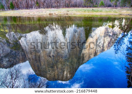 El Capitan is reflected in the still waters of the Merced River. Yosemite National Park, California - stock photo