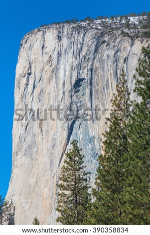 el Capitan with  the blue sky background,top covered with snow. - stock photo