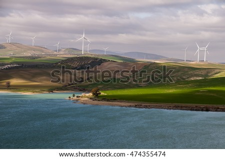 El Chorro reservoir with the bottom area of wind turbines in Ardales, town of Malaga, Spain