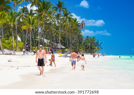 El Cortecito, Punta Cana, Dominican Republic- April 26, 2015: People walking along the coastline and sunbathing on one of the best beach in Caribbean area - stock photo