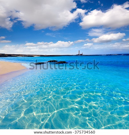 El Cotillo beach and Toston lighthouse at Fuerteventura Canary Islands - stock photo