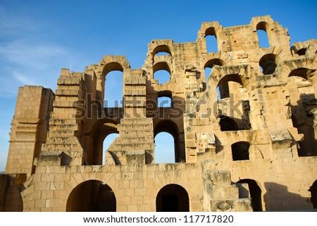 El Djem Amphitheatre walls. Arches of roman biggest amphitheater in africa in El Djam, Tunisia - stock photo