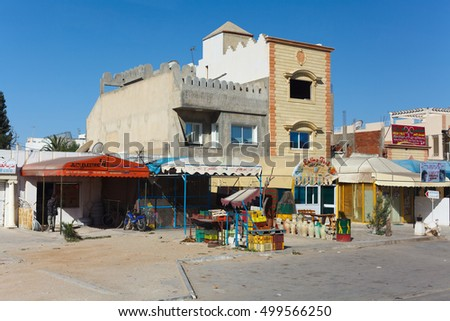 EL DJEM, TUNISIA, AFRICA-CIRCA MAY, 2012: Small private shop is on the dwelling building on streets of small town. Scenes of Tunisia, Africa