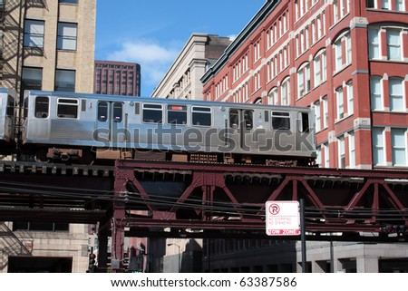 El. elevated, overhead commuter train in Chicago moving through the city. - stock photo