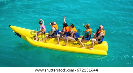 El Gouna/Egypt - April 11, 2015: Sea attraction, happy people ride the inflatable watercraft boat