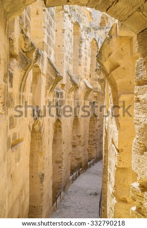 EL JEM, TUNISIA - SEPTEMBER 1, 2015: The Roman amphitheatre is the large archaeological site with the maze of halls, corridors and inner chambers, on September 1, in El Jem. - stock photo