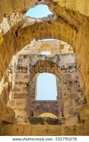 EL JEM, TUNISIA - SEPTEMBER 1, 2015: The system of the stone arches makes the walls stronger, on September 1, in El Jem. - stock photo