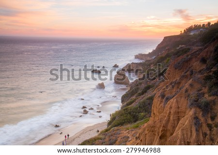 El Matador State beach as the setting sun casts a soft pink glow - stock photo